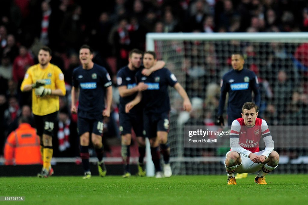 A dejected Jack Wilshere of Arsenal looks on following his team's 1-0 defeat during the FA Cup with Budweiser fifth round match between Arsenal and Blackburn Rovers at Emirates Stadium on February 16, 2013 in London, England.