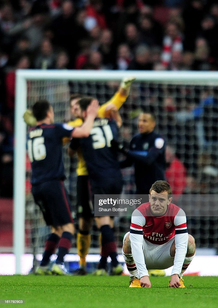 A dejected <a gi-track='captionPersonalityLinkClicked' href=/galleries/search?phrase=Jack+Wilshere&family=editorial&specificpeople=5446655 ng-click='$event.stopPropagation()'>Jack Wilshere</a> of Arsenal looks on following his team's 1-0 defeat during the FA Cup with Budweiser fifth round match between Arsenal and Blackburn Rovers at Emirates Stadium on February 16, 2013 in London, England.