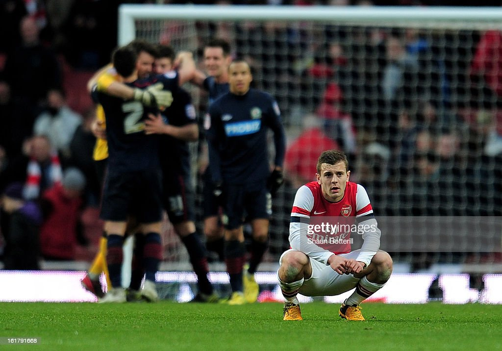 A dejected <a gi-track='captionPersonalityLinkClicked' href=/galleries/search?phrase=Jack+Wilshere&family=editorial&specificpeople=5446655 ng-click='$event.stopPropagation()'>Jack Wilshere</a> of Arsenal reacts following his team's 1-0 defeat during the FA Cup with Budweiser fifth round match between Arsenal and Blackburn Rovers at Emirates Stadium on February 16, 2013 in London, England.