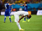 A dejected Jack Wilshere of England looks down as Italy celebrate defeating England 21 during the 2014 FIFA World Cup Brazil Group D match between...