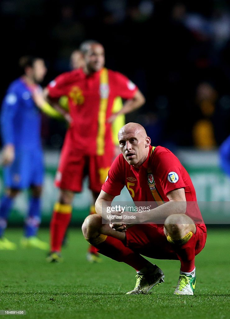 A dejected <a gi-track='captionPersonalityLinkClicked' href=/galleries/search?phrase=James+Collins+-+Welsh+Soccer+Player&family=editorial&specificpeople=15167252 ng-click='$event.stopPropagation()'>James Collins</a> of Wales looks on folowing his team's 2-1 defeat during the FIFA 2014 World Cup qualifier between Wales and Croatia at The Liberty Stadium on March 26, 2013 in Swansea, Wales.