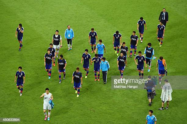 A dejected Japan team walk off the field after being defeated by the Ivory Coast 21 during the 2014 FIFA World Cup Brazil Group C match between the...