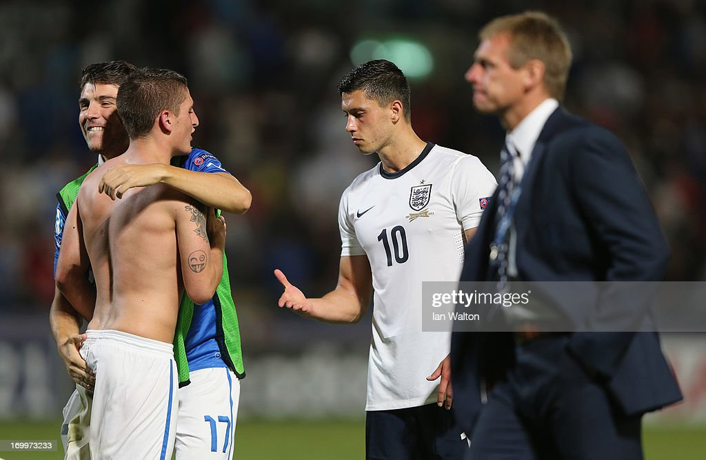 A dejected Jason Lowe (C) of England offers to shake hands as Alberto Paloschi (#17)of Italy celebrates after the UEFA European U21 Championships, Group A match between England and Italy at the Bloomfield Stadium on June 5, 2013 in Tel Aviv, Israel.