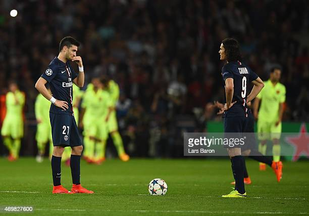 Dejected Javier Pastore and Edinson Cavani of PSG prepare to restart after conceding a second goal during the UEFA Champions League Quarter Final...