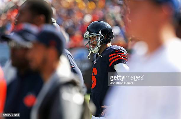 A dejected Jay Cutler of the Chicago Bears stands on the sidelines after throwing an interception during the fourth quarter of their game against the...