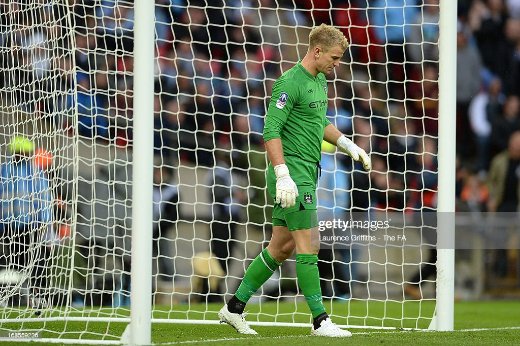 Dejected Joe Hart of Manchester City after defeat in the FA Cup with Budweiser Final match between Manchester City and Wigan Athletic at Wembley Stadium on May 11, 2013 in London, England.