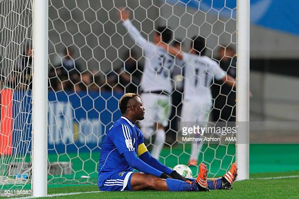 A dejected Joel Kimwaki of TP Mazembe as Tsukasa Shiotani of Sanfrecce Hiroshima celebrates after scoring a goal to make it 01 during the FIFA World...