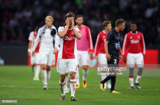 A dejected Joel Veltman of Ajax during the UEFA Champions League Qualifying Third Round match between Ajax and OSC Nice at Amsterdam Arena on August...