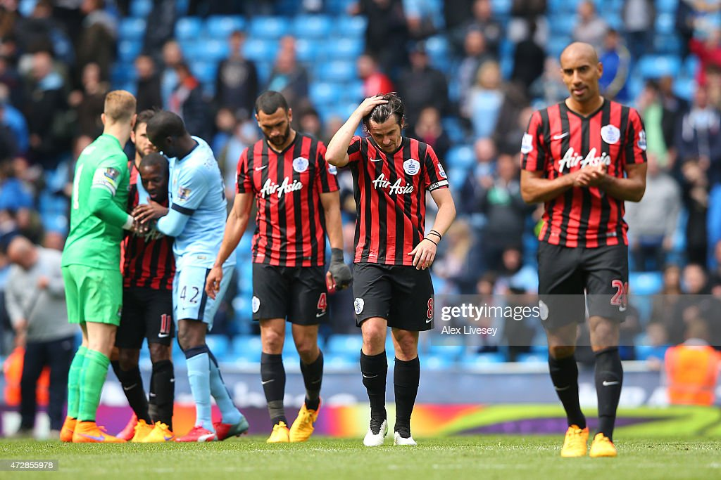 A dejected <a gi-track='captionPersonalityLinkClicked' href=/galleries/search?phrase=Joey+Barton&family=editorial&specificpeople=211284 ng-click='$event.stopPropagation()'>Joey Barton</a> (C) of QPR and teammates react following their team's relegation during the Barclays Premier League match between Manchester City and Queens Park Rangers at the Etihad Stadium on May 10, 2015 in Manchester, England.