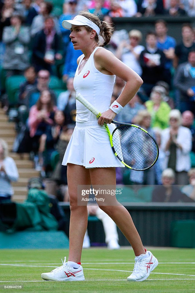 A dejected Johanna Konta of Great Britain reacts during the Ladies Singles second round match against Eugenie Bouchard of Canada on day four of the Wimbledon Lawn Tennis Championships at the All England Lawn Tennis and Croquet Club on June 30, 2016 in London, England.