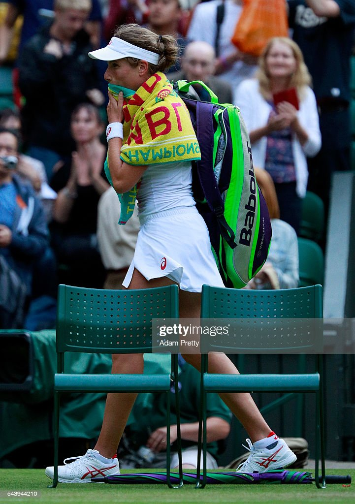 A dejected <a gi-track='captionPersonalityLinkClicked' href=/galleries/search?phrase=Johanna+Konta&family=editorial&specificpeople=4482643 ng-click='$event.stopPropagation()'>Johanna Konta</a> of Great Britain walks off court following her defeat during the Ladies Singles second round match against Eugenie Bouchard of Canada on day four of the Wimbledon Lawn Tennis Championships at the All England Lawn Tennis and Croquet Club on June 30, 2016 in London, England.