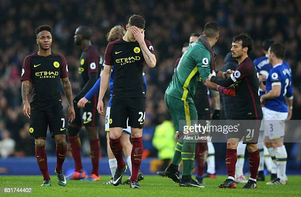 A dejected John Stones of Manchester City and teammates walk off the pitch following their team's 40 defeat during the Premier League match between...