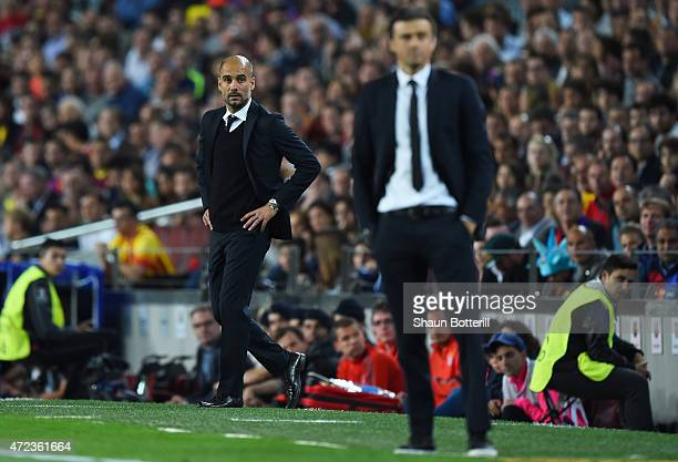 A dejected Josep Guardiola the head coach of Bayern Muenchen looks on past Luis Enrique the head coach of Barcelona during the UEFA Champions League...