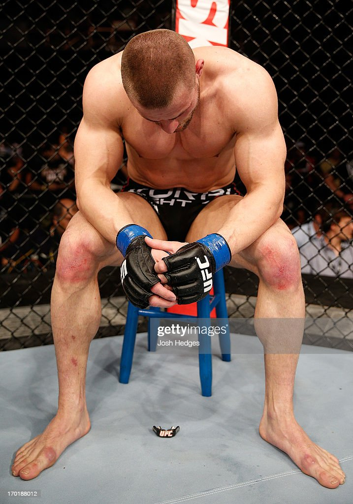 A dejected Karlos Vemola sits on his stool after his submission loss to Caio Magalhaes in their middleweight fight during the UFC on FUEL TV event at Paulo Sarasate Arena on June 8, 2013 in Fortaleza, Ceara, Brazil.