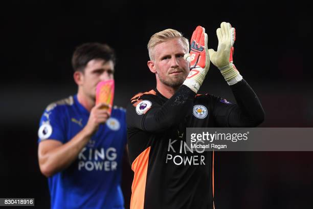 A dejected Kasper Schmeichel of Leicester City applauds the travelling fans following their team's 43 defeat during the Premier League match between...
