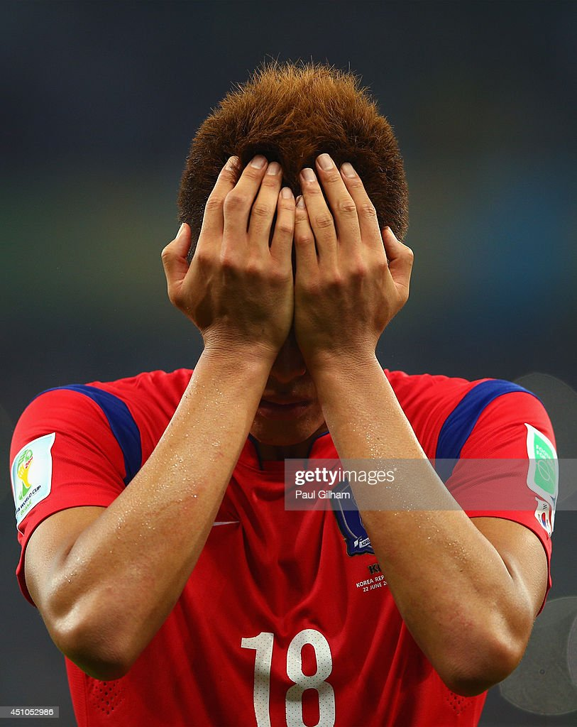 A dejected <a gi-track='captionPersonalityLinkClicked' href=/galleries/search?phrase=Kim+Shin-Wook&family=editorial&specificpeople=5862723 ng-click='$event.stopPropagation()'>Kim Shin-Wook</a> of South Korea reacts after being defeated by Algeria 4-2 during the 2014 FIFA World Cup Brazil Group H match between South Korea and Algeria at Estadio Beira-Rio on June 22, 2014 in Porto Alegre, Brazil.