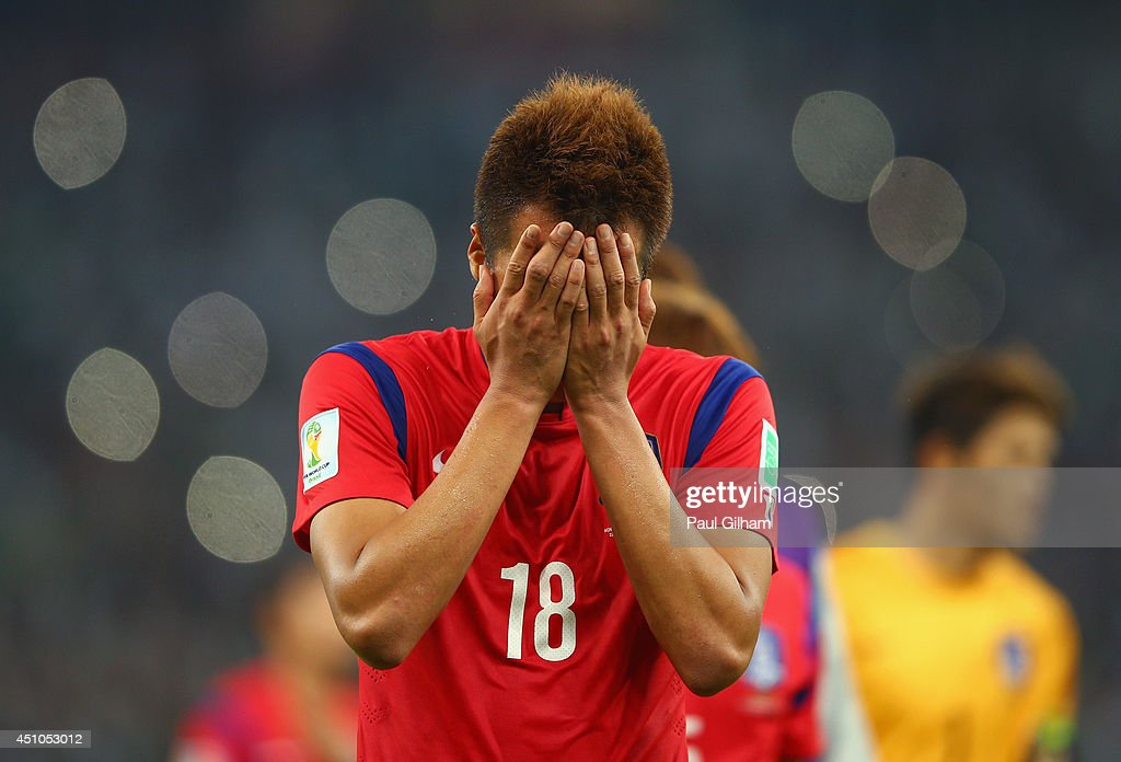 A dejected Kim Shin-Wook of South Korea reacts after being defeated by Algeria 4-2 during the 2014 FIFA World Cup Brazil Group H match between South Korea and Algeria at Estadio Beira-Rio on June 22, 2014 in Porto Alegre, Brazil.