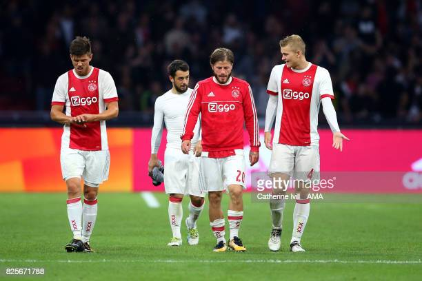 A dejected Klass Jan Huntelaar Lasse Schone and Matthijs Ligt of Ajax during the UEFA Champions League Qualifying Third Round match between Ajax and...