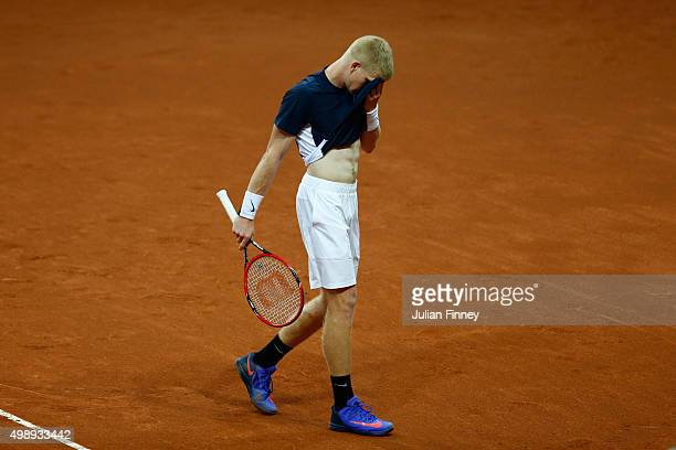 A dejected Kyle Edmund of Great Britain reacts during the singles match against David Goffin of Belgium on day one of the Davis Cup Final 2015 at...