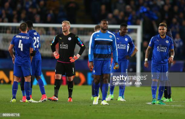 A dejected Leicester City goalkeeper Kasper Schmeichel and Wes Morgan of Leicester City after the UEFA Champions League Quarter Final second leg...