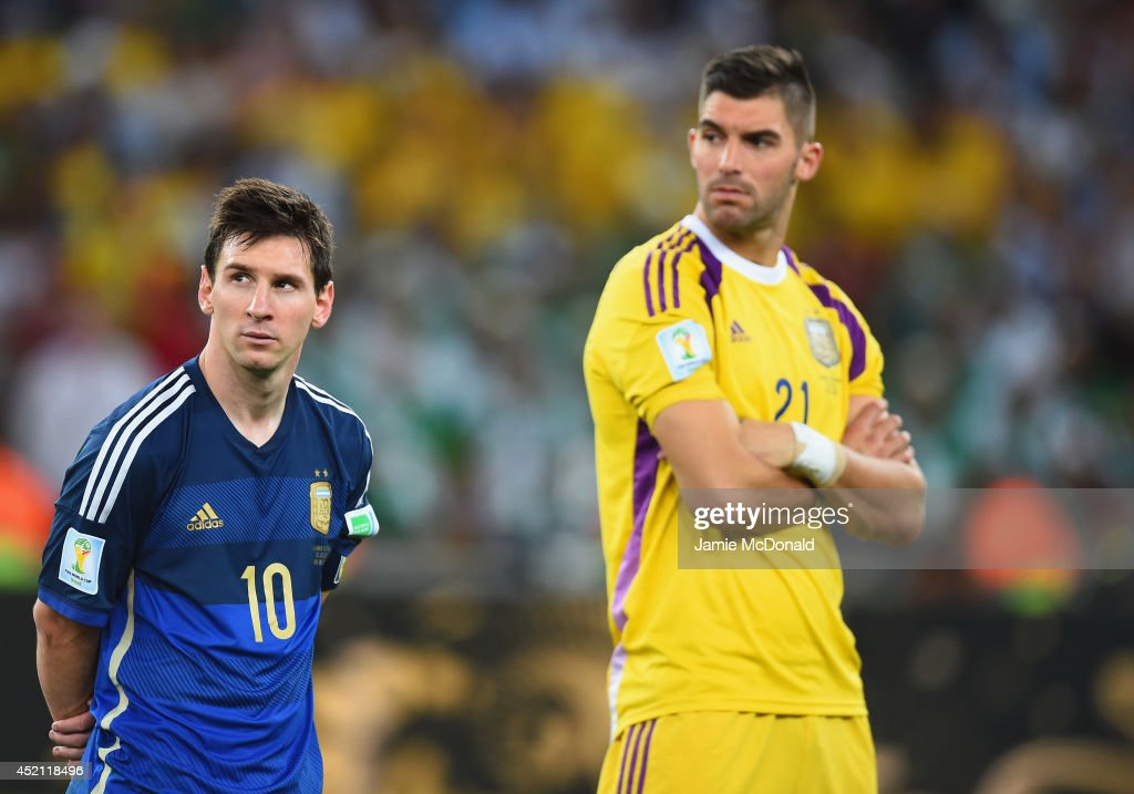 A dejected <a gi-track='captionPersonalityLinkClicked' href=/galleries/search?phrase=Lionel+Messi&family=editorial&specificpeople=453305 ng-click='$event.stopPropagation()'>Lionel Messi</a> (L) and <a gi-track='captionPersonalityLinkClicked' href=/galleries/search?phrase=Mariano+Andujar&family=editorial&specificpeople=804546 ng-click='$event.stopPropagation()'>Mariano Andujar</a> of Argentina look on after being defeated by Germany 1-0 in extra time during the 2014 FIFA World Cup Brazil Final match between Germany and Argentina at Maracana on July 13, 2014 in Rio de Janeiro, Brazil.