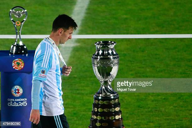 A dejected Lionel Messi of Argentina looks on after being defeated by Chile during the 2015 Copa America Chile Final match between Chile and...