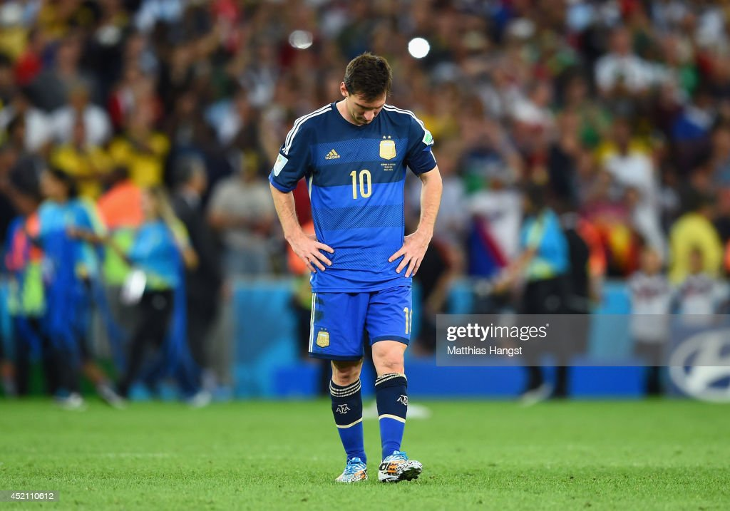 A dejected Lionel Messi of Argentina reacts after being defeated by Germany 1-0 in extra time during the 2014 FIFA World Cup Brazil Final match between Germany and Argentina at Maracana on July 13, 2014 in Rio de Janeiro, Brazil.