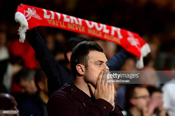 A dejected Liverpool fan reacts following his team's 33 draw during the Barclays Premier League match between Crystal Palace and Liverpool at...