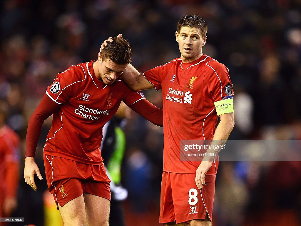 Dejected Liverpool players <a gi-track='captionPersonalityLinkClicked' href=/galleries/search?phrase=Jordan+Henderson+-+Soccer+Player&family=editorial&specificpeople=4940390 ng-click='$event.stopPropagation()'>Jordan Henderson</a> and <a gi-track='captionPersonalityLinkClicked' href=/galleries/search?phrase=Steven+Gerrard&family=editorial&specificpeople=202052 ng-click='$event.stopPropagation()'>Steven Gerrard</a> react following their team's 1-1 draw and exit from the competition during the UEFA Champions League group B match between Liverpool and FC Basel 1893 at Anfield on December 9, 2014 in Liverpool, United Kingdom.