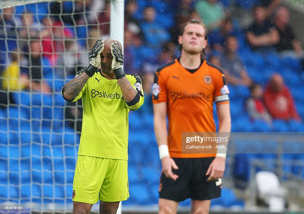 A dejected looking Carl Ikeme and Richard Stearman of Wolverhampton Wanderers after Kenwyne Jones of Cardiff City scores to make it 1-0 during the match the Sky Bet Championship match between Cardiff City and Wolverhampton Wanderers at Cardiff City Stadium on August 22, 2015 in Cardiff, Wales.