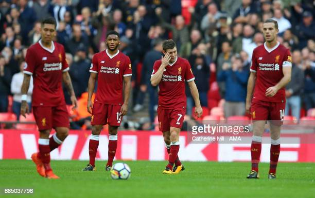 A dejected looking James Milner of Liverpool walks with his team mates during the Premier League match between Tottenham Hotspur and Liverpool at...