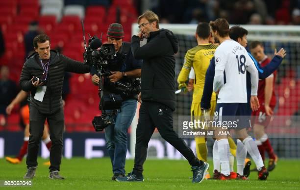 A dejected looking Jurgen Klopp the head coach / manager of Liverpool walks off after the Premier League match between Tottenham Hotspur and...
