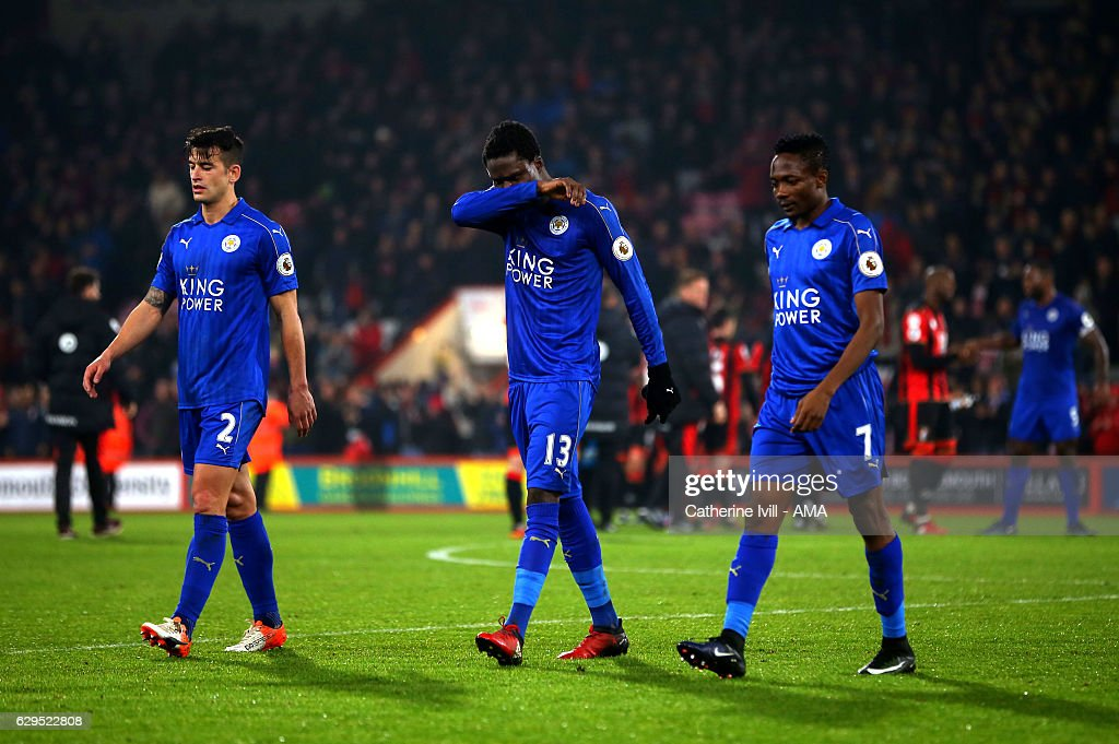 A dejected looking Luis Hernandez, Daniel Amartey and Ahmed Musa of Leicester City walk off after the Premier League match between AFC Bournemouth and Leicester City at Vitality Stadium on December 13, 2016 in Bournemouth, England.