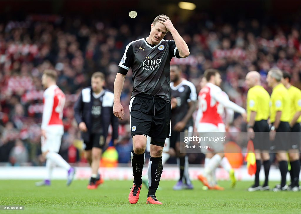 A dejected looking <a gi-track='captionPersonalityLinkClicked' href=/galleries/search?phrase=Robert+Huth&family=editorial&specificpeople=206878 ng-click='$event.stopPropagation()'>Robert Huth</a> of Leicester City after the Premier League match between Arsenal and Leicester City at Emirates Stadium on February 14, 2016 in London, United Kingdom.