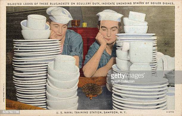 Dejected looks of these Bluejackets on scullery duty indicate unending stacks of soiled dishes US Navy Training Station Sampson NY