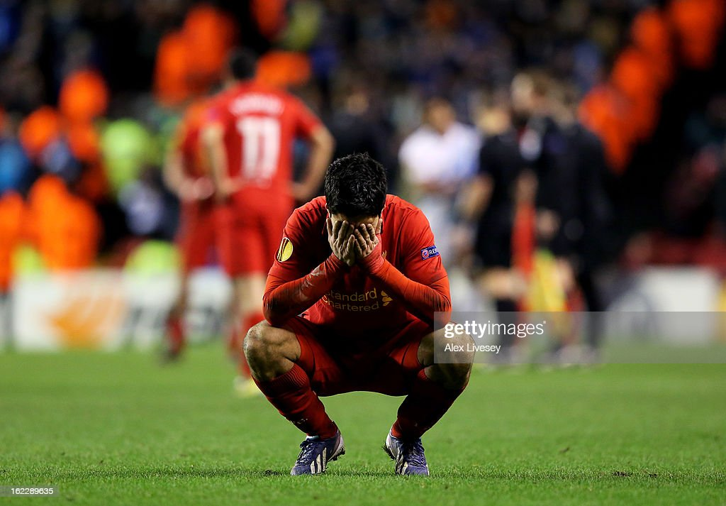 A dejected Luis Suarez of Liverpool reacts as his team win on the night but exit the competition during the UEFA Europa League round of 32 second leg match between Liverpool FC and FC Zenit St Petersburg at Anfield on February 21, 2013 in Liverpool, England.