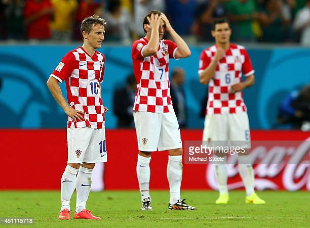 A dejected Luka Modric Ivan Rakitic and Dejan Lovren of Croatia react after a 31 defeat to Mexico in the 2014 FIFA World Cup Brazil Group A match...