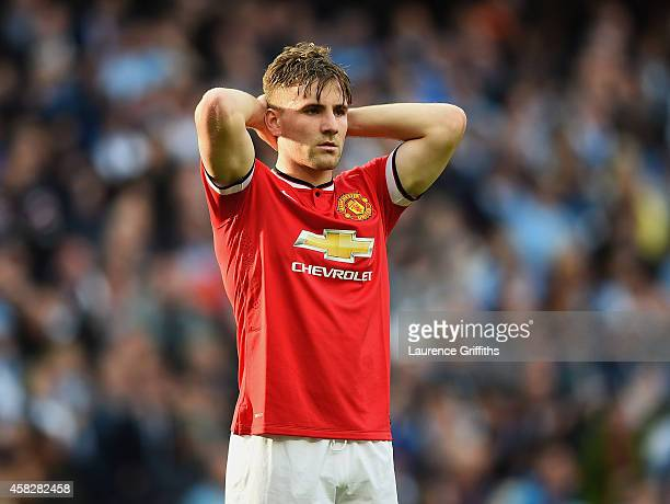A dejected Luke Shaw of Manchester United looks on during the Barclays Premier League match between Manchester City and Manchester United at Etihad...