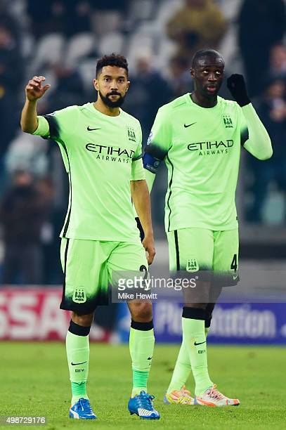 Dejected Manchester City players Gael Clichy and Yaya Toure look on following their team's 10 defeat during the UEFA Champions League group D match...