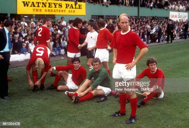 Dejected Manchester United players look enviously at the celebrating Derby County team after United's 41 defeat David Sadler manager Wilf McGuinness...