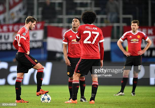 Dejected Manchester United players look on after conceding a third goal during the UEFA Champions League group B match between VfL Wolfsburg and...