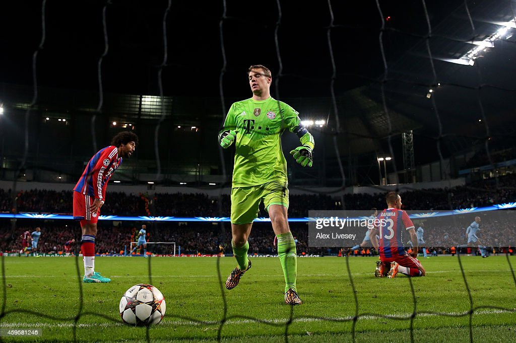 A dejected <a gi-track='captionPersonalityLinkClicked' href=/galleries/search?phrase=Manuel+Neuer&family=editorial&specificpeople=764621 ng-click='$event.stopPropagation()'>Manuel Neuer</a> of Bayern Muenchen and teammates react after <a gi-track='captionPersonalityLinkClicked' href=/galleries/search?phrase=Sergio+Aguero&family=editorial&specificpeople=1100704 ng-click='$event.stopPropagation()'>Sergio Aguero</a> of Manchester City scores the matchwinning goal during the UEFA Champions League Group E match between Manchester City and FC Bayern Muenchen at the Etihad Stadium on November 25, 2014 in Manchester, United Kingdom.