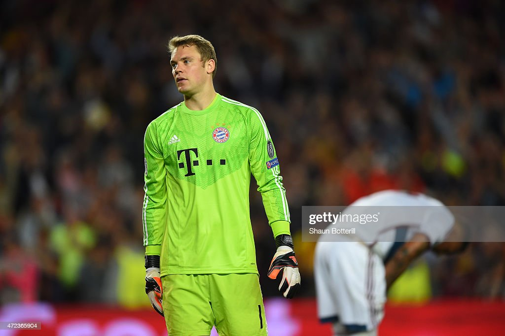 A dejected <a gi-track='captionPersonalityLinkClicked' href=/galleries/search?phrase=Manuel+Neuer&family=editorial&specificpeople=764621 ng-click='$event.stopPropagation()'>Manuel Neuer</a> of Bayern Muenchen reacts followinghis team's 3-0 defeat during the UEFA Champions League Semi Final, first leg match between FC Barcelona and FC Bayern Muenchen at Camp Nou on May 6, 2015 in Barcelona, Spain.