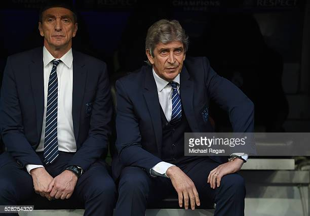 A dejected Manuel Pellegrini the manager of Manchester City looks on during the UEFA Champions League semi final second leg match between Real Madrid...