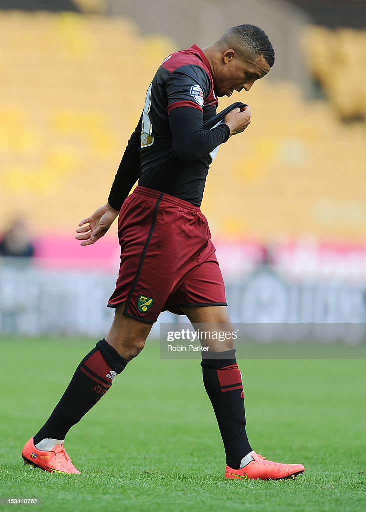 A dejected <a gi-track='captionPersonalityLinkClicked' href=/galleries/search?phrase=Martin+Olsson&family=editorial&specificpeople=4185617 ng-click='$event.stopPropagation()'>Martin Olsson</a> of Norwich City walks off the pitch after being shown a Red Card by Referee Simon Hooper during the Sky Bet Championship match between Wolverhampton Wanderers and Norwich City at the Molineux Stadium on August 10, 2014 in Wolverhampton, England.