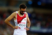 A dejected Martyn Rooney of England after the Men's 400 metres Final at Hampden Park during day seven of the Glasgow 2014 Commonwealth Games on July...