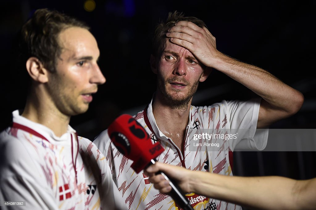 A dejected <a gi-track='captionPersonalityLinkClicked' href=/galleries/search?phrase=Mathias+Boe&family=editorial&specificpeople=651077 ng-click='$event.stopPropagation()'>Mathias Boe</a> (L) and <a gi-track='captionPersonalityLinkClicked' href=/galleries/search?phrase=Carsten+Mogensen&family=editorial&specificpeople=651076 ng-click='$event.stopPropagation()'>Carsten Mogensen</a> (R) of Denmark after lossing against Yong Dae Lee and Yeon Seong Yoo of Korea in the semifinals during the Li-Ning BWF World Badminton Championships at Ballerup Super Arena on August 29, 2014 in Copenhagen, Denmark.