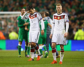 Dejected Mats Hummels and Andre Schurrle of Germany after defeat in the UEFA EURO 2016 Qualifier group D match between Republic of Ireland and...