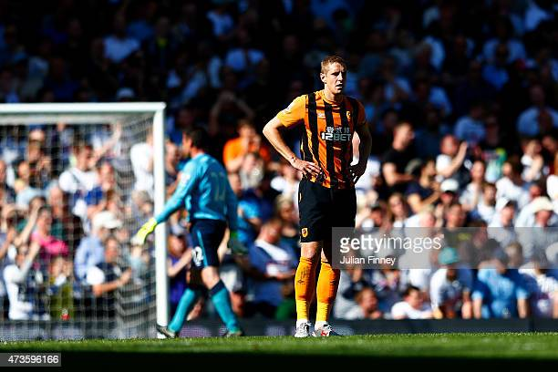 A dejected Michael Dawson of Hull City looks to the ground during the Barclays Premier League match between Tottenham Hotspur and Hull City at White...