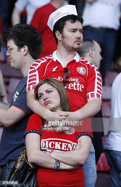 Dejected Middlesbrough fans after Middlesbrough are relegated after being beaten 21 in the English Premier League football match by West Ham United...